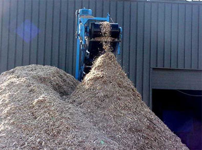 Wood processed through shredder and turned into reusable wood chip