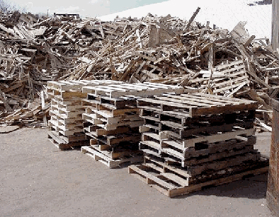 Wood waste prepared to be processed through shredder